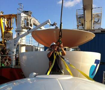 Acutec engineers assemble the Sea Tel C-Band VSAT alongside the ship in Sydney for Telstra